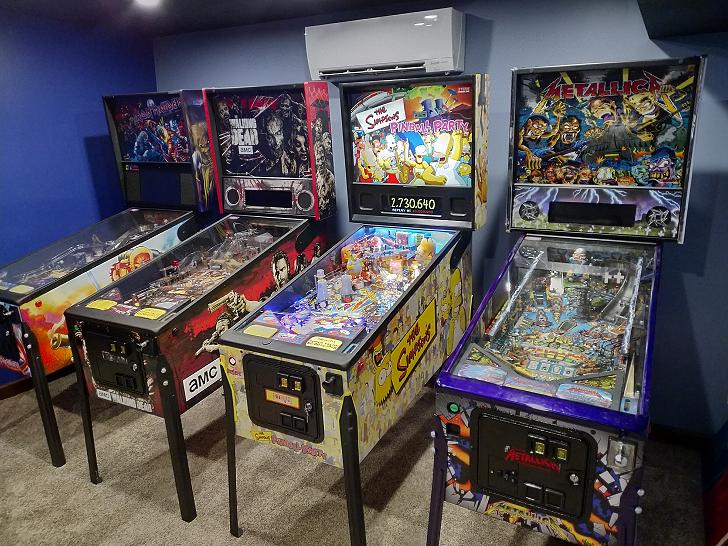 Row of four pinball machines